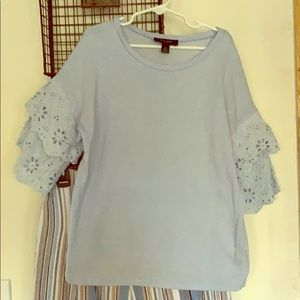 Light blue knit top with eyelet belled sleeves